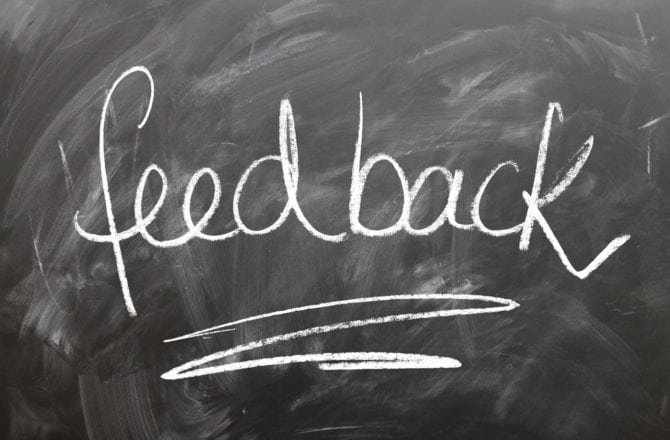 the word feedback written on a chalk board